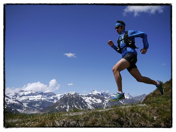 Ben testing exciting new inov-8 product, including the Race Ultra Vest, in the Alps. Photo by www.iancorless.com